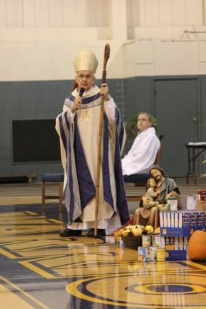Bishop Dale Melczek thanks the Noll community for the food donated to St. Joseph's soup kitchen