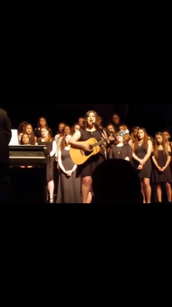 Senior%2C+Mayra+Pena+preforming+a+solo+at+Band+and+Choir+concert.+