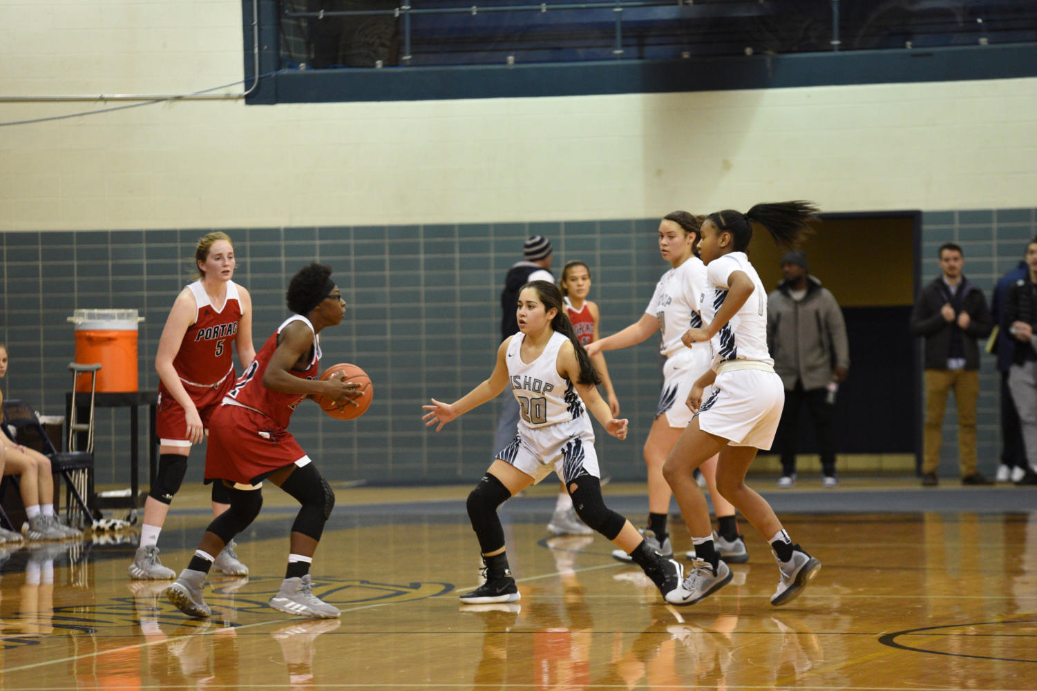 Freshman Brianna Gonzalez joins senior Courtney Blakely and sophomore Danneli Campbell in trapping a Portage High School defender on Nov. 26 at Bishop Noll.