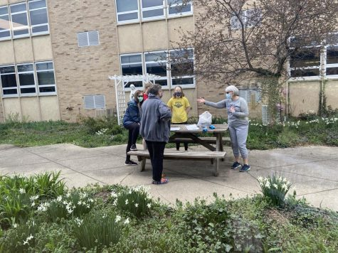 The environmental club meets in the courtyard to decide how to clean it up. The group decided to to clean the courtyard as one of their projects for the upcoming Earth Day.