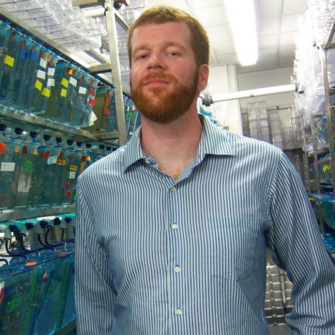 DNA Discovery. Clements  poses with his notable research at Rice University.